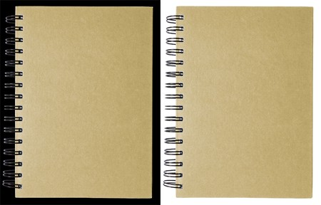Brown notebook isolated on black and white photo