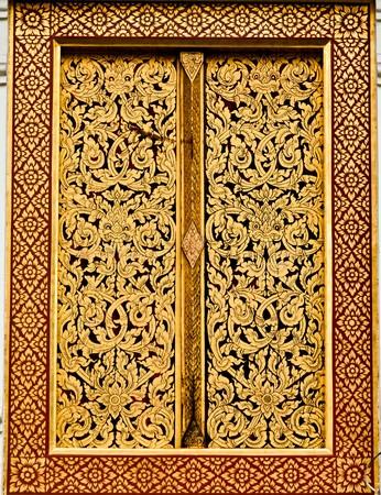 Golden Art on the temple window photo