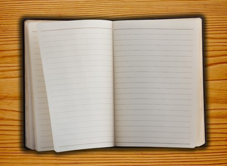 scuff: Old Notebook Inside On Wood Stock Photo