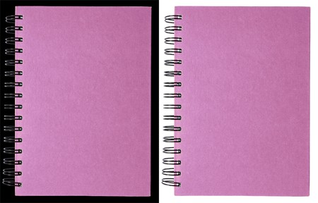Pink notebook isolated on black and white photo