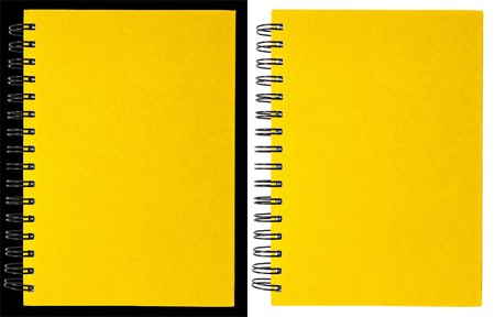 Yellow notebook isolated on black and white photo