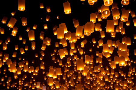 Floating Lantern during Firework Festival in Thailand photo
