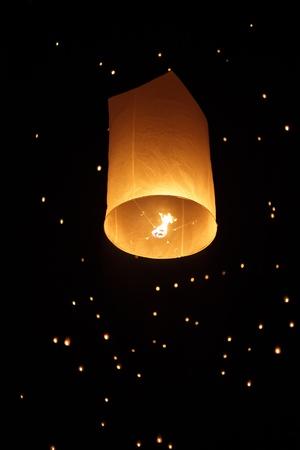 Single Floating Lantern during Firework Festival in Thailand Stock Photo