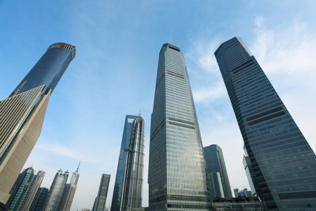 Shanghai, China - MARCH 10: Downtown building near Oriental Pearl Tower on March 10, 2011 in Shanghai, China. photo