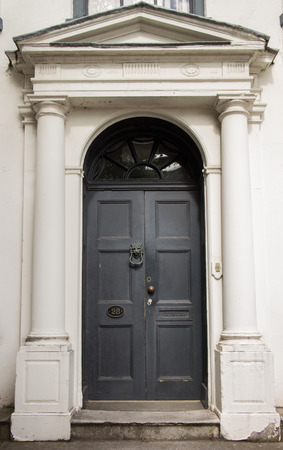 residential structure: A black door entrance