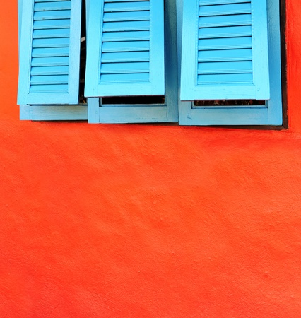 Blue window on a red wall Stock Photo