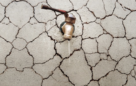 save water: Tap water on a cracked wall