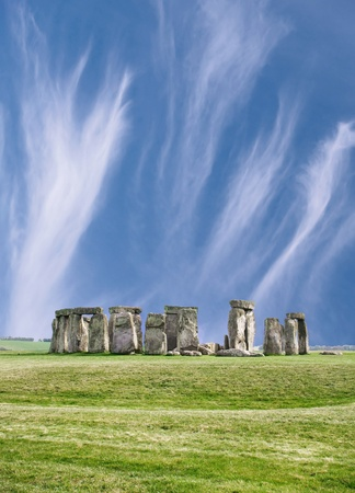 Stonehenge historic site on green grass under blue sky  Stonehenge is a UNESCO world heritage site in England