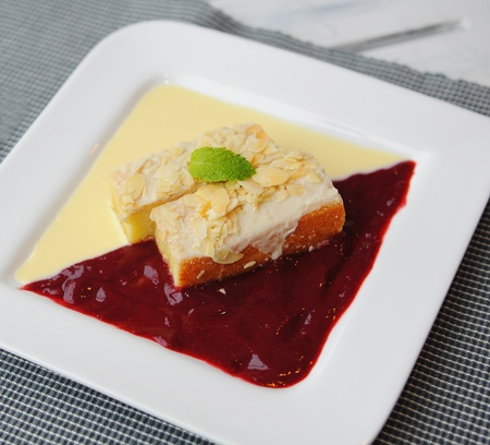 delicious cake with strawberry and cream sauce photo