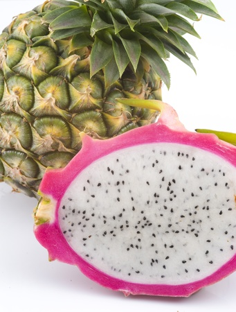 closeup on dragon fruit and pineapple fruit photo