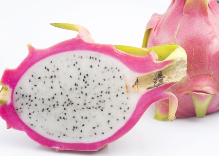 closeup on whole and half of Dragon fruit photo