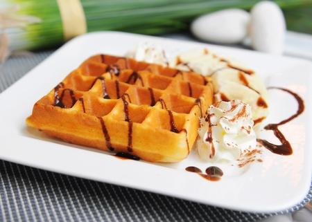Waffle on top with chocolate and banana