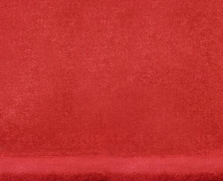 burgundy colour: closeup on a red velvet chair