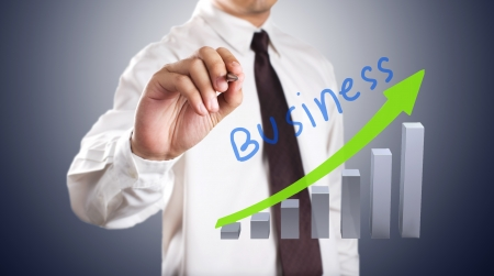 Business man drawing growth graph