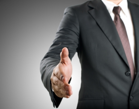 shake hands: Business man extending hand to shake Stock Photo