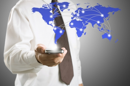 Business man showing smart phone with world map for social and internet connectivity concept photo