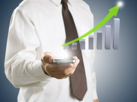 Business man showing smart phone with growth graph in background