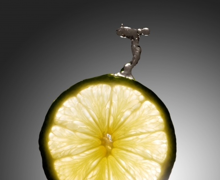 Water drop on fresh lime with beautiful lighting background photo