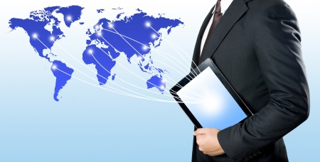 Business man holding digital tablet PC to connect with the world Stock Photo
