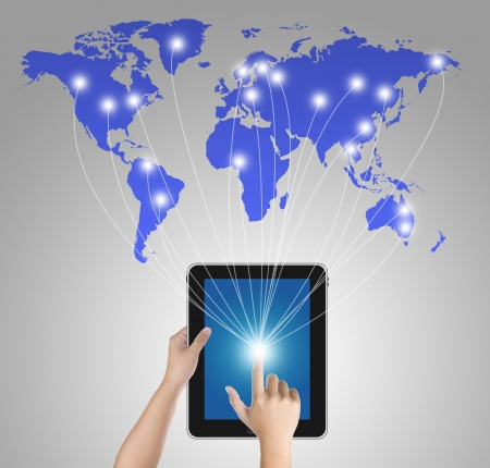 Finger pressing digital tablet pc to connect with the world Stock Photo - 13845497