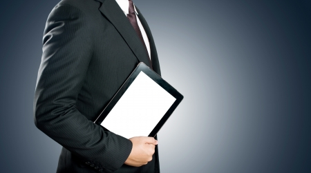 Business man holding digital tablet PC with blank white screen photo