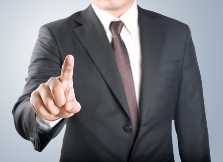 Business man showing finger to be number one Stock Photo