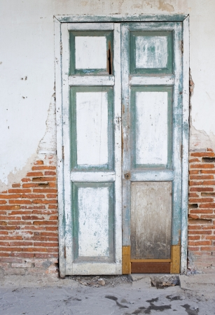 Door of an old abandoned building photo