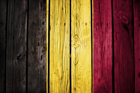 belgian flag painted on grunge wooden texture Stock Photo