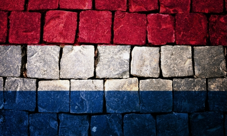 Holland flag painted on stone wall photo