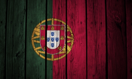 Portugal flag painted on wood background