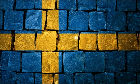 Sweden flag painted on old wall background photo