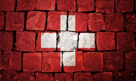 Switzerland flag painted on old wall background Stock Photo