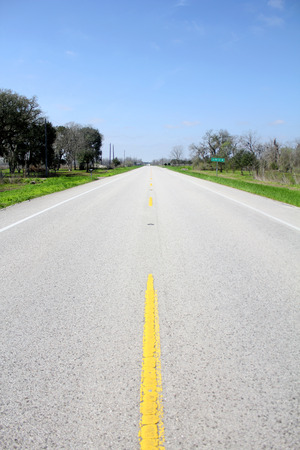 mid distance: in the middle of an American road through the countryside
