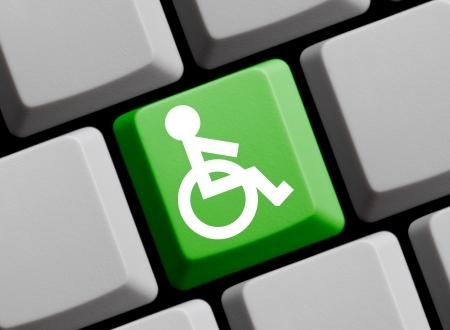 Rollstuhl - Symbol auf Computer-Tastatur Lizenzfreie Bilder