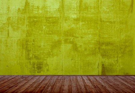 Empty room with yellow wall and wood floor photo