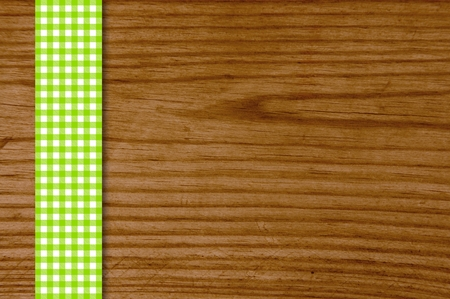 Wooden background with green and white tablecloths strip photo