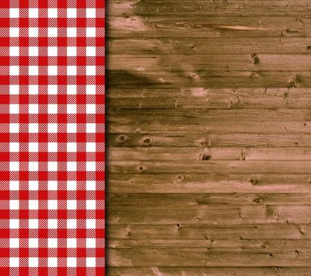 Holz Hintergrund und Tischdecke in rot und weiß Lizenzfreie Bilder