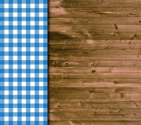 Wood background and tablecloth in blue and white photo