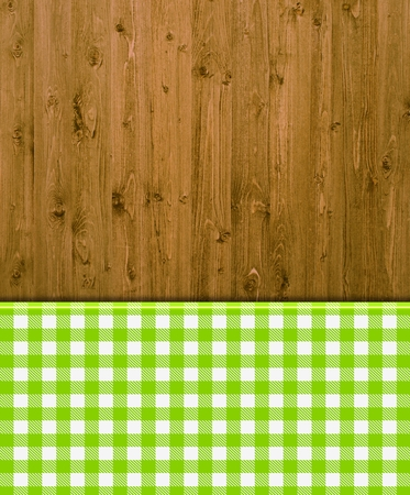 Wooden background with greene and white tablecloths patterns photo
