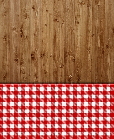 Wooden background with red and white tablecloths patterns photo