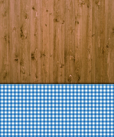 Wooden background with blue and white tablecloths patterns photo