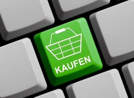 webshop: Computer Keyboard with Symbol showing Buy in german Stock Photo