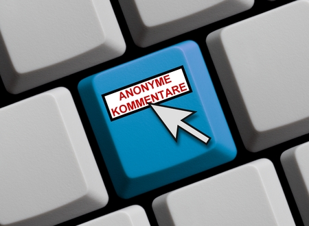 mobbing: Computer Keyboard with mouse arrow showing anonymous comments in german language Stock Photo