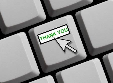Computer keyboard with mouse arrow showing thank you