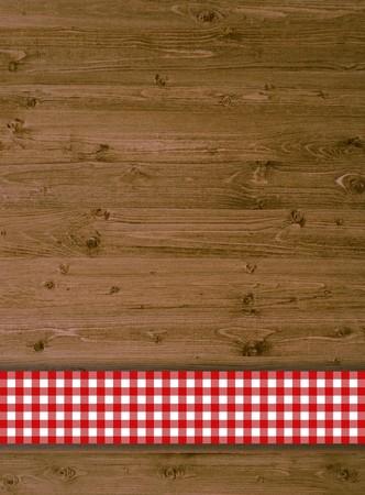 木材の背景に赤いテーブル クロス 写真素材