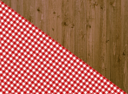 background check: Wooden table with diagonal tablecloth in red and white Stock Photo