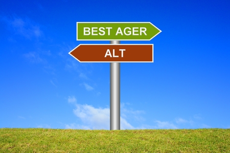 groundbreaking: Signpost sign with blue sky and green grass showing old or best ager in german language Stock Photo