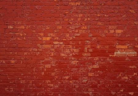 Antecedentes de una pared de ladrillo antiguo con piedras rojas Foto de archivo