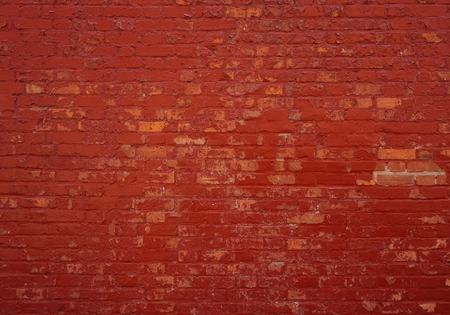 exterior wall: Background of an old brick wall with red stones