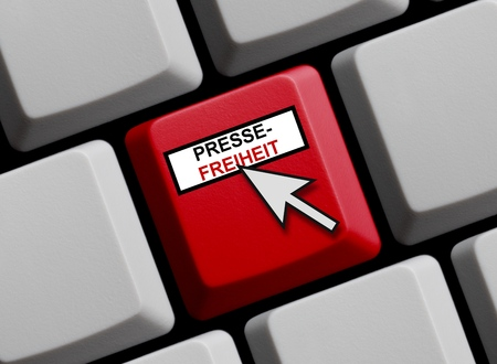 censorship: Computer Keyboard with mouse arrow showing Press freedom online in german language